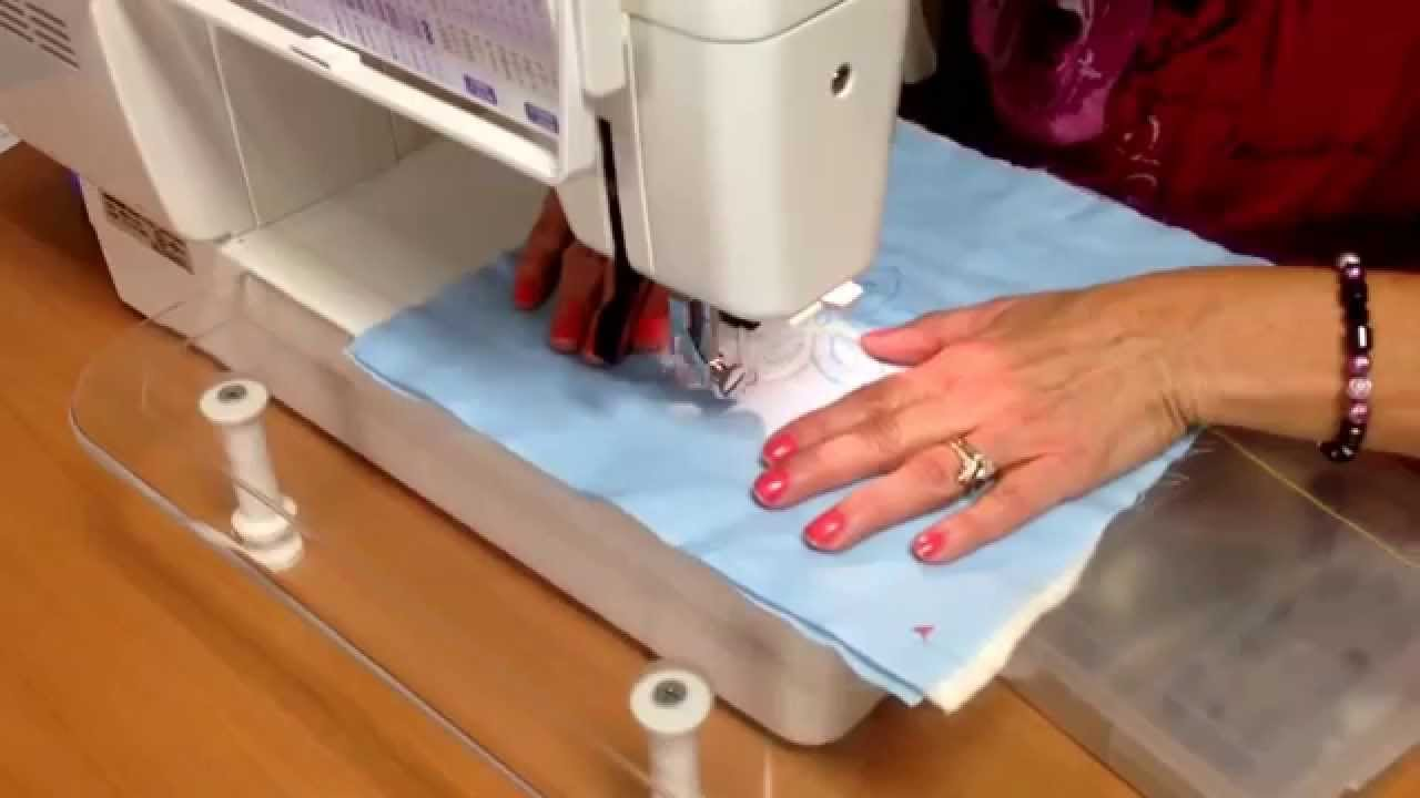 quilt blue fabric with a sewing machine